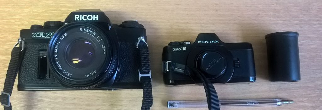 Pentax Auto 110 SLR in comparison with a Ricoh 35mm SLR