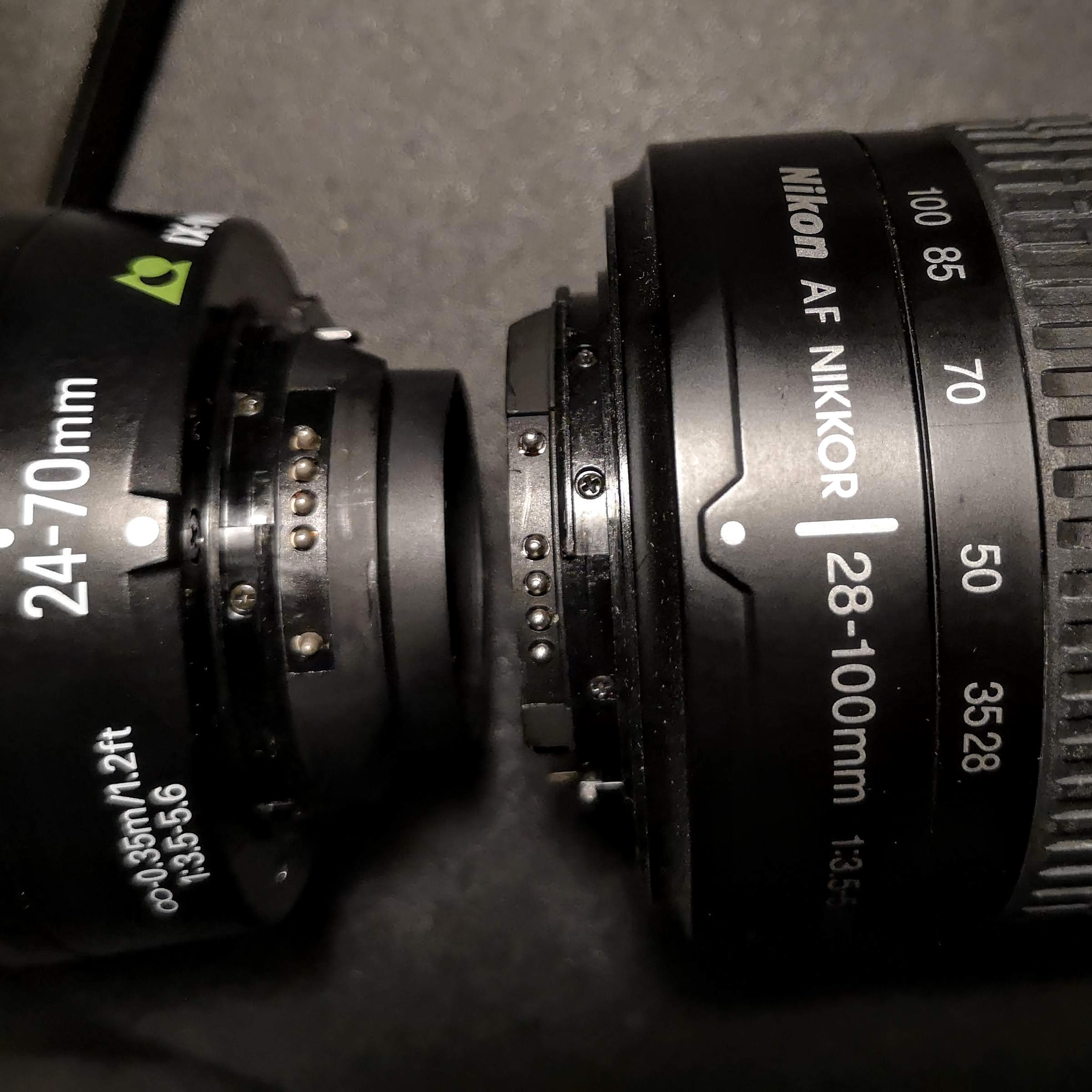 Nikkor IX 24-70mm (l) and AF Nikkor 28-100mm AF-D G (r). Note the massive difference in rear projection.