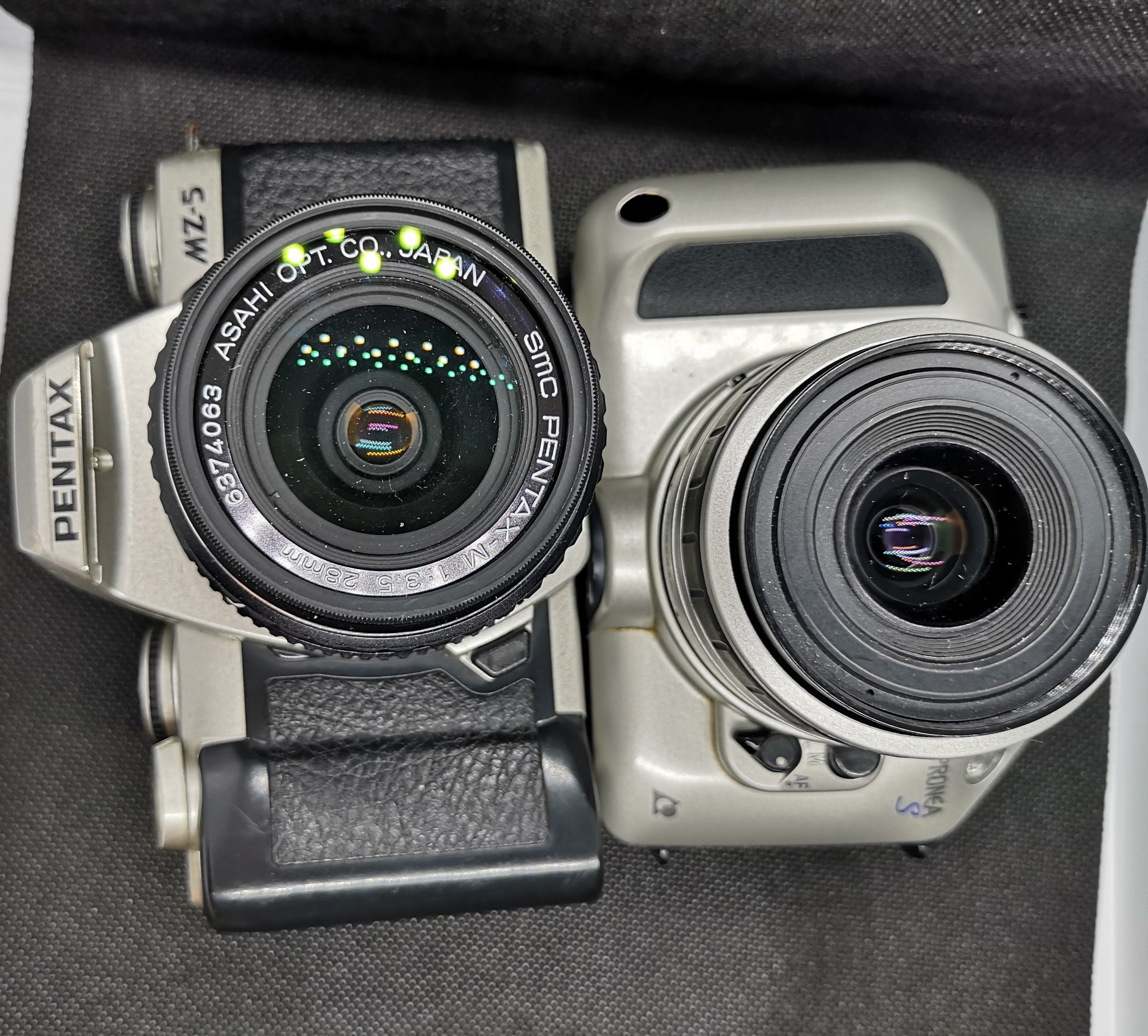 Pentax MZ-5 and Nikon Pronea S. The Prnoea is smaller but not by that much