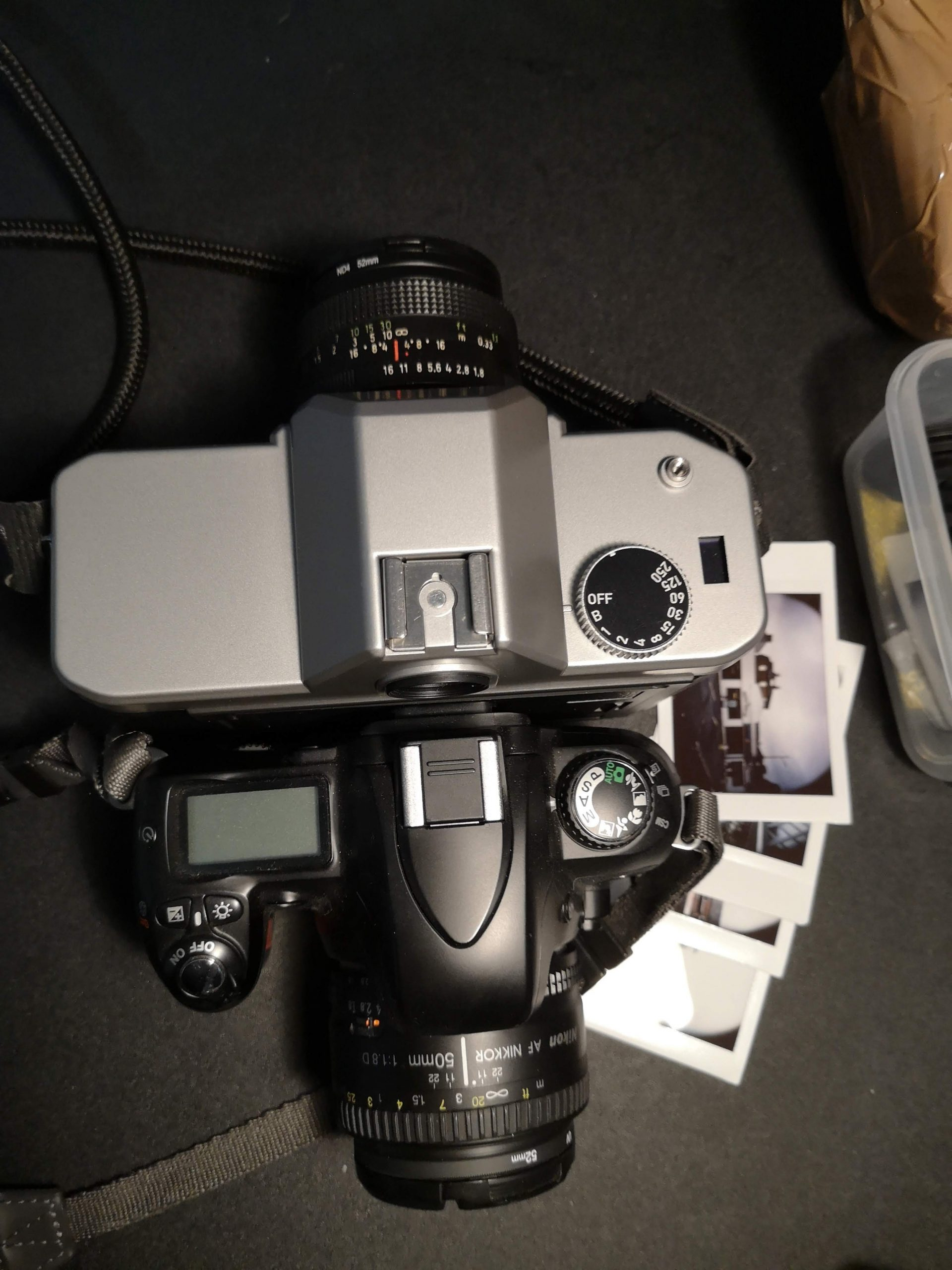 Nons SL42 (top) with a Nikon F75 (bottom) for scale