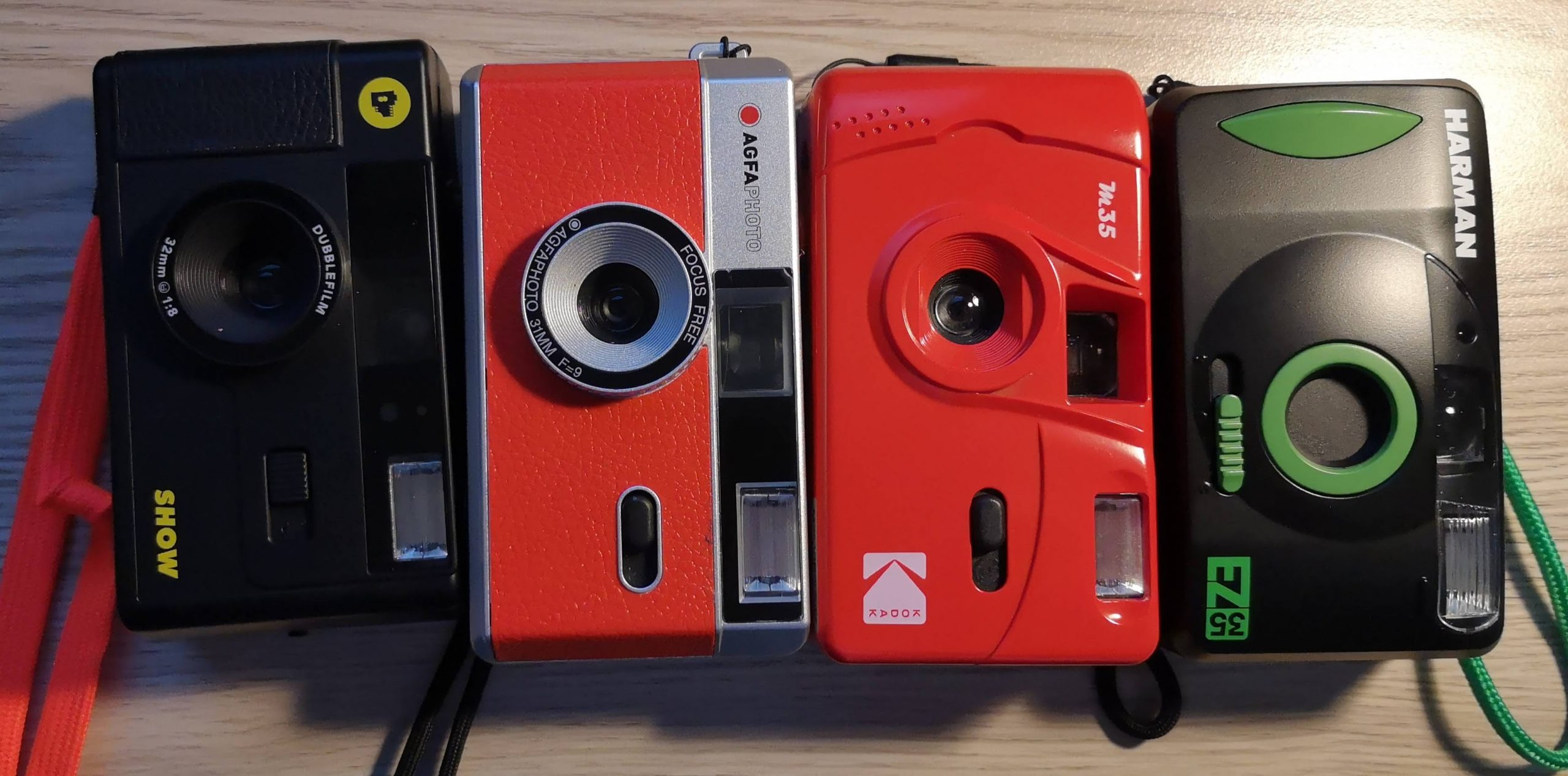 (L) to (R) Dubblefilm Show, Agfaphoto Analogue Phoro Camera, Kodak M35 and Our EZ35.